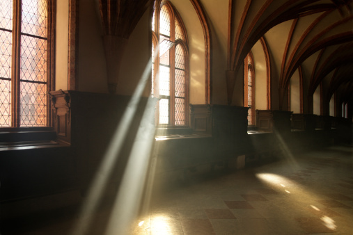 Ray of light in abbey corridor