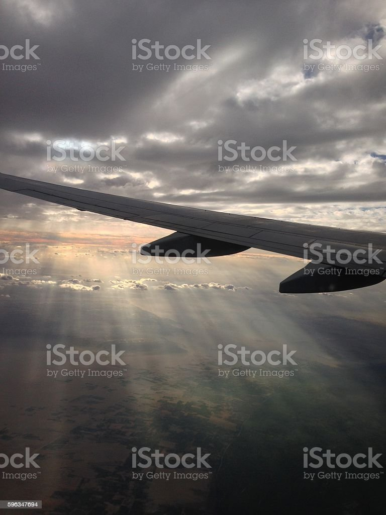Ray of Light in Cloudy Sky with Airplane Wing Lizenzfreies stock-foto