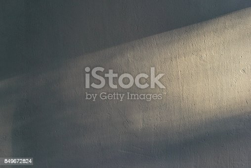 Ray of light on textured wall background