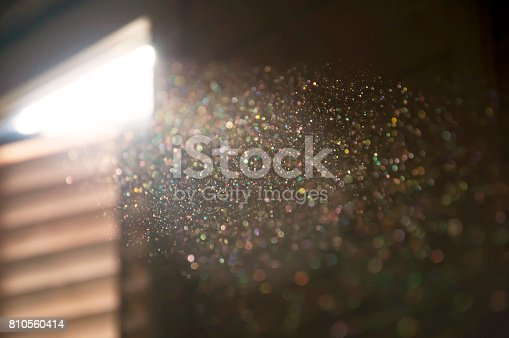 istock A ray of sun coming through the wooden shutters, illuminates dust on the inside of a dark room. 810560414