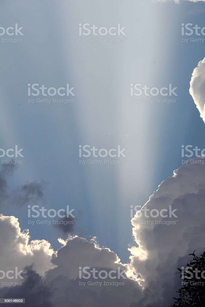 Ray of sunshine. Clouds. stock photo