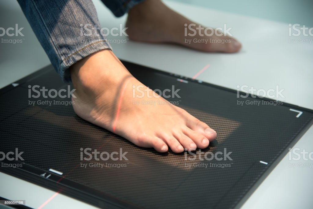 X ray scanning at foot in hospital, Medical and Health care concept stock photo