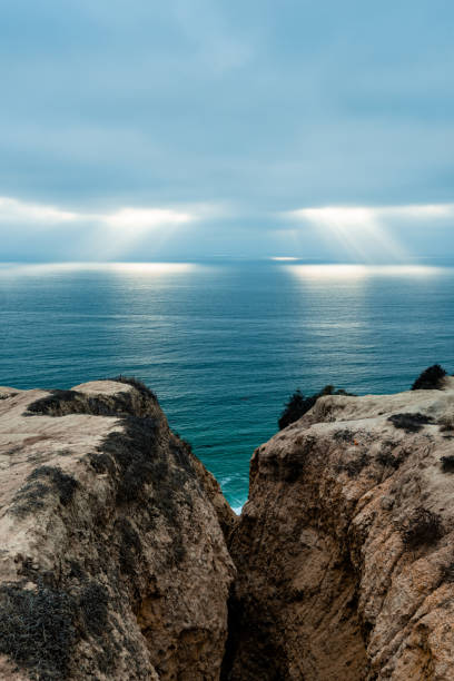 Rays of Light Over the Ocean from the Cliffs at Torrey Pines stock photo
