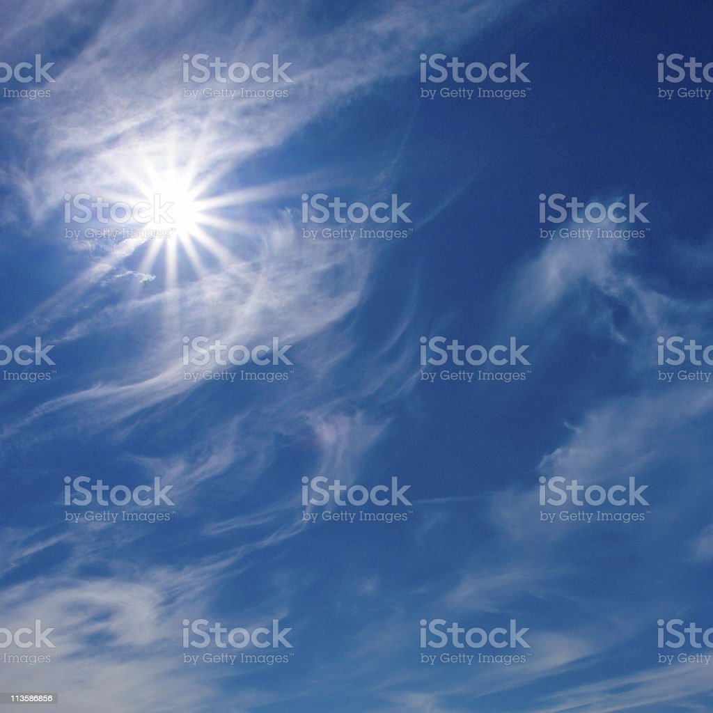 Rays of sun on blue sky royalty-free stock photo