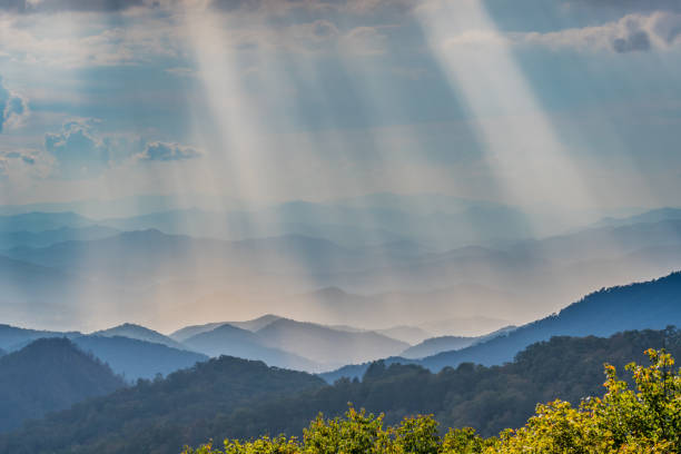 Rays of Sun Shine Over the Blue Ridge Mountains Rays of Sun Shine Over the Blue Ridge Mountains in North Carolina blue ridge mountains stock pictures, royalty-free photos & images
