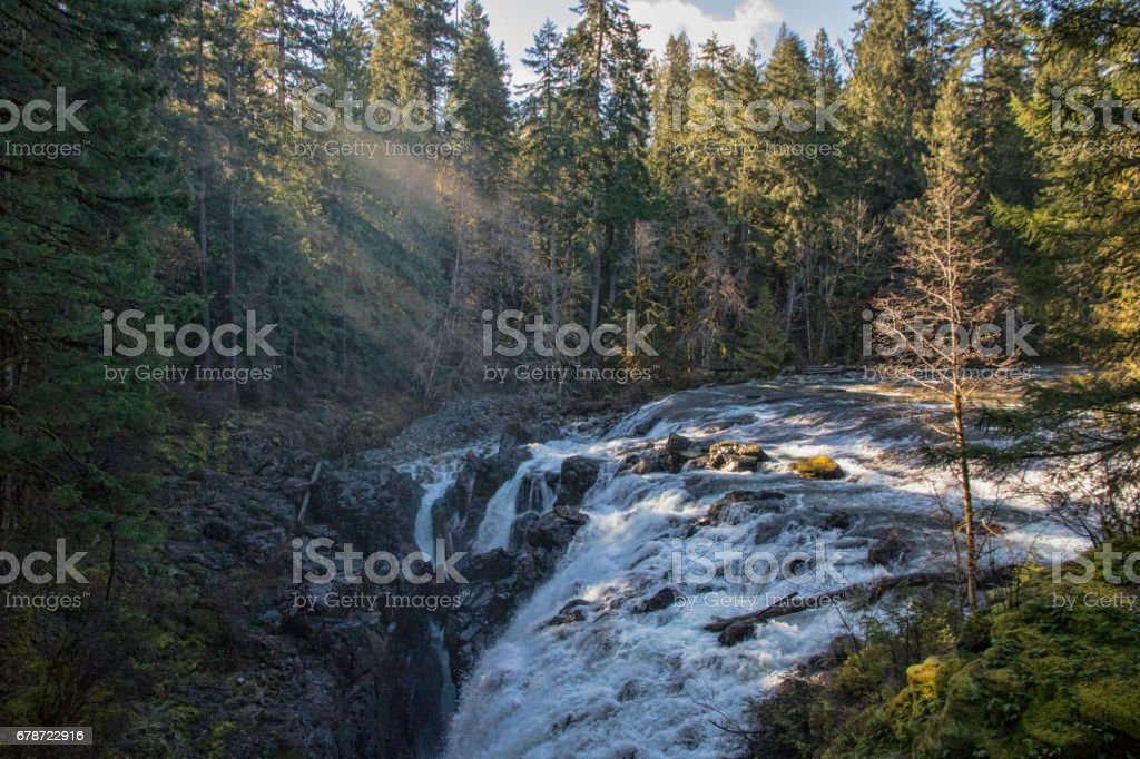 Rays of Sunlight at Englishman River Falls, British Columbia, Canada stock photo