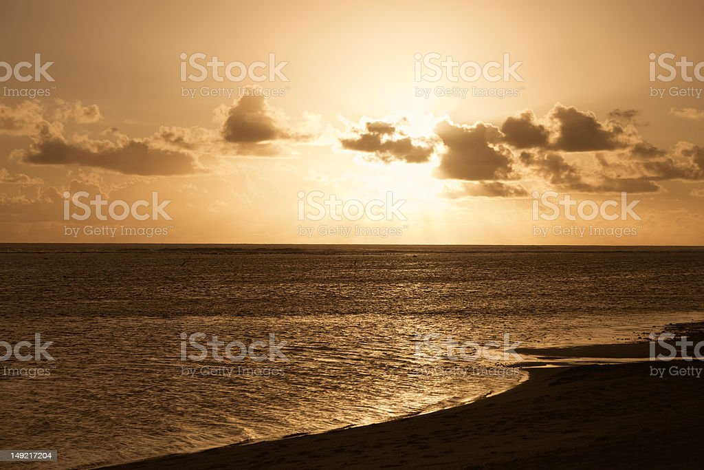 Rays of Sunlight beam from behind Clouds royalty-free stock photo