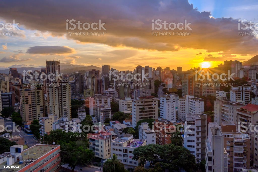 Rays of Sunlight filtering through City Buildings stock photo