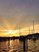 Golden sunset over the water at the marina