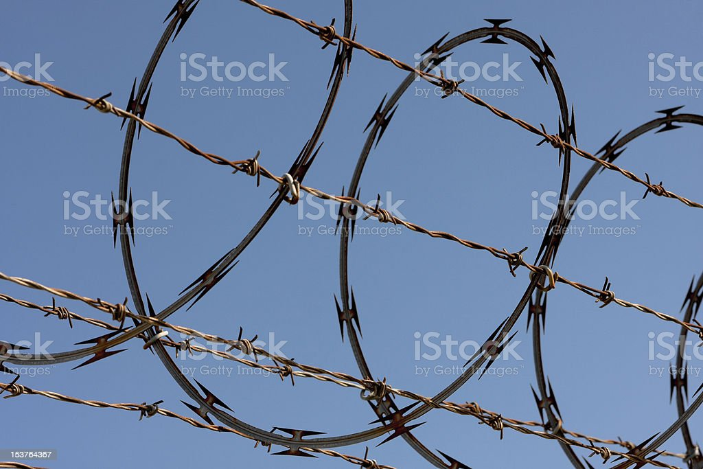 Razor And Barbed Wire Fence Stock Photo & More Pictures of Barbed ...