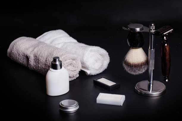 Razor and brush on stand, towels, perfume, balsam and blades on a black  background. Razor and brush on stand, towels, perfume, balsam and blades on a black background. shaving brush shaving cream razor old fashioned stock pictures, royalty-free photos & images