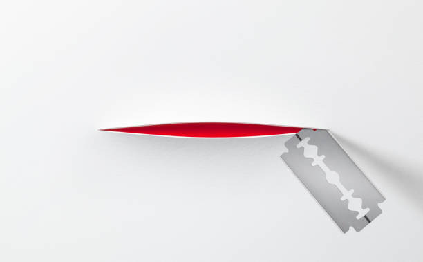 razor blade cut white paper - knife wound stock photos and pictures