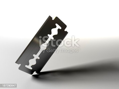 A razor blade cutting into a surface. 3D render with HDRI lighting and raytraced textures.