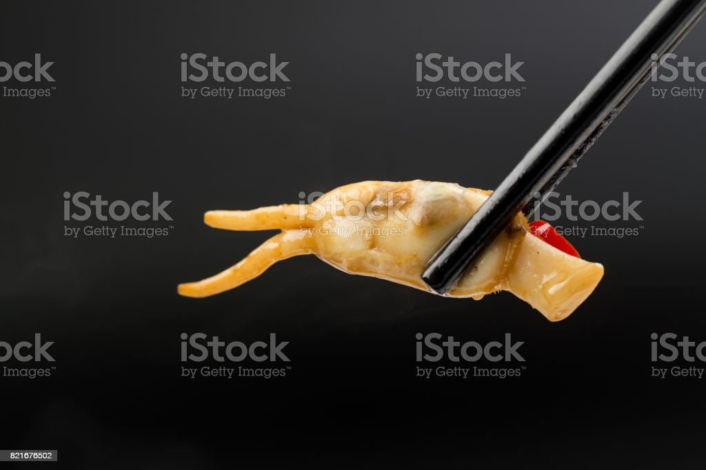 Razor Clam Hold By Chopstick With Black Background Stock Photo ...