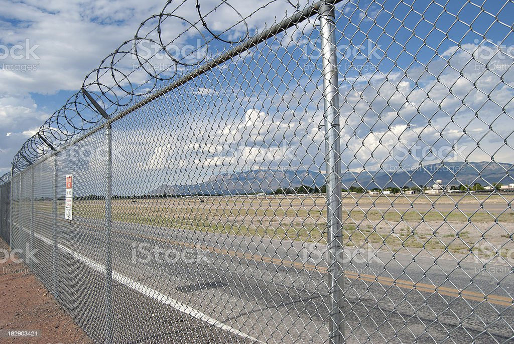 Razor Wire Above Airport Fence stock photo