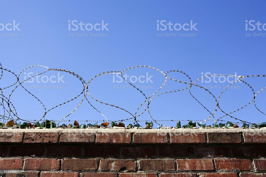 Razor wire, blue sky #2 royalty-free stock photo