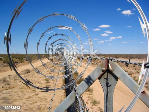 Razor Wire fence in the Mojave Desert on a beautiful day.