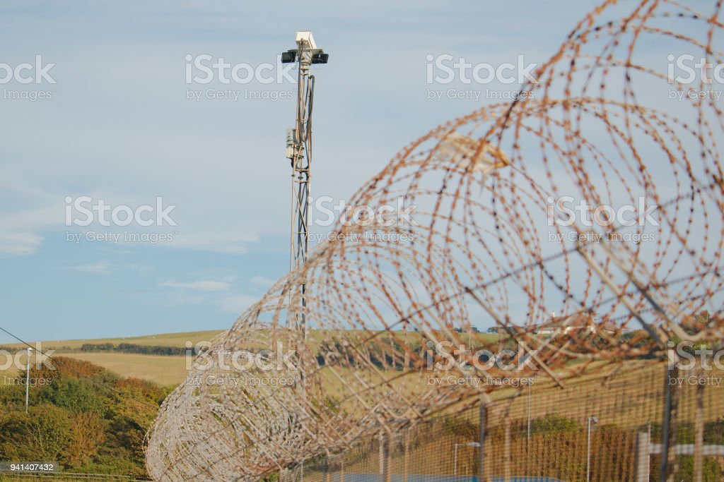Razor Wire Fence With Cctv Tower Stock Photo & More Pictures of ...