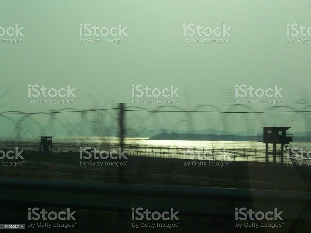 Razor wire fencing along the Han River near Seoul, South Korea stock photo
