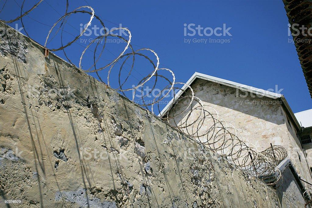 Razor wire prison wall royalty-free stock photo