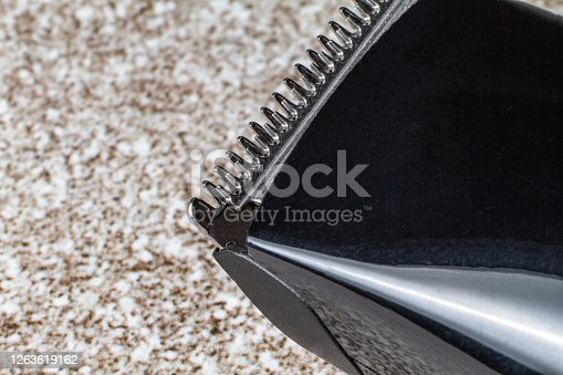 1041901666 istock photo A razor with a trimmer for cutting and shaving hair, with a comb nozzle. 1263619162