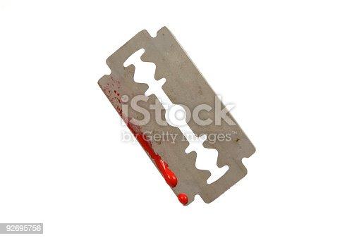 Razor blade with blood on white background