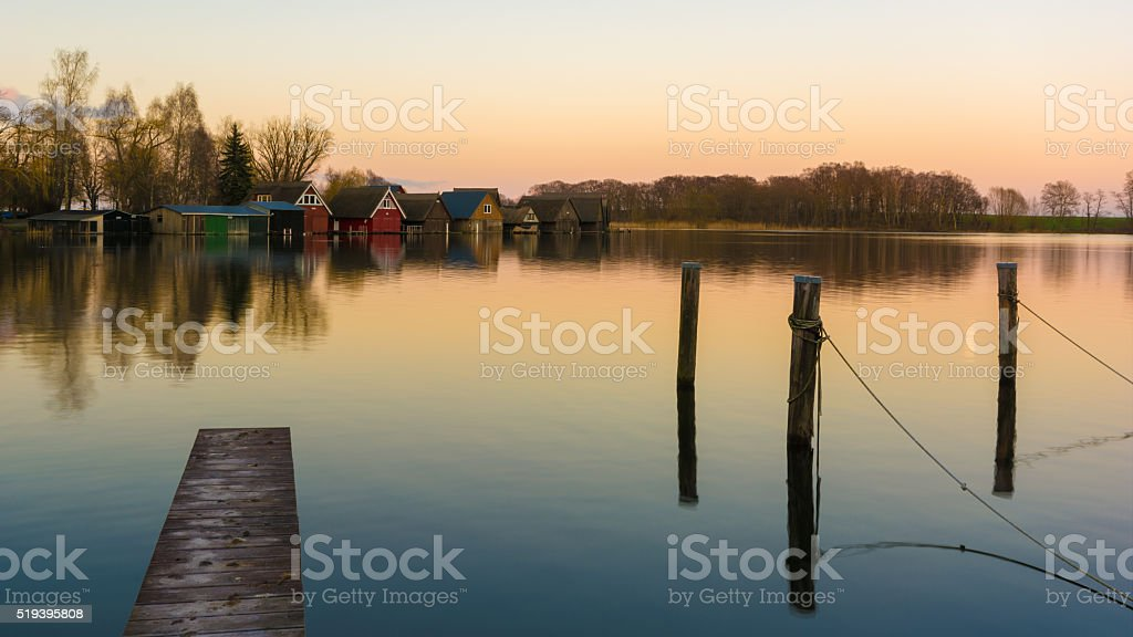 Röbel Boatshouses with a wodden landing stage stock photo
