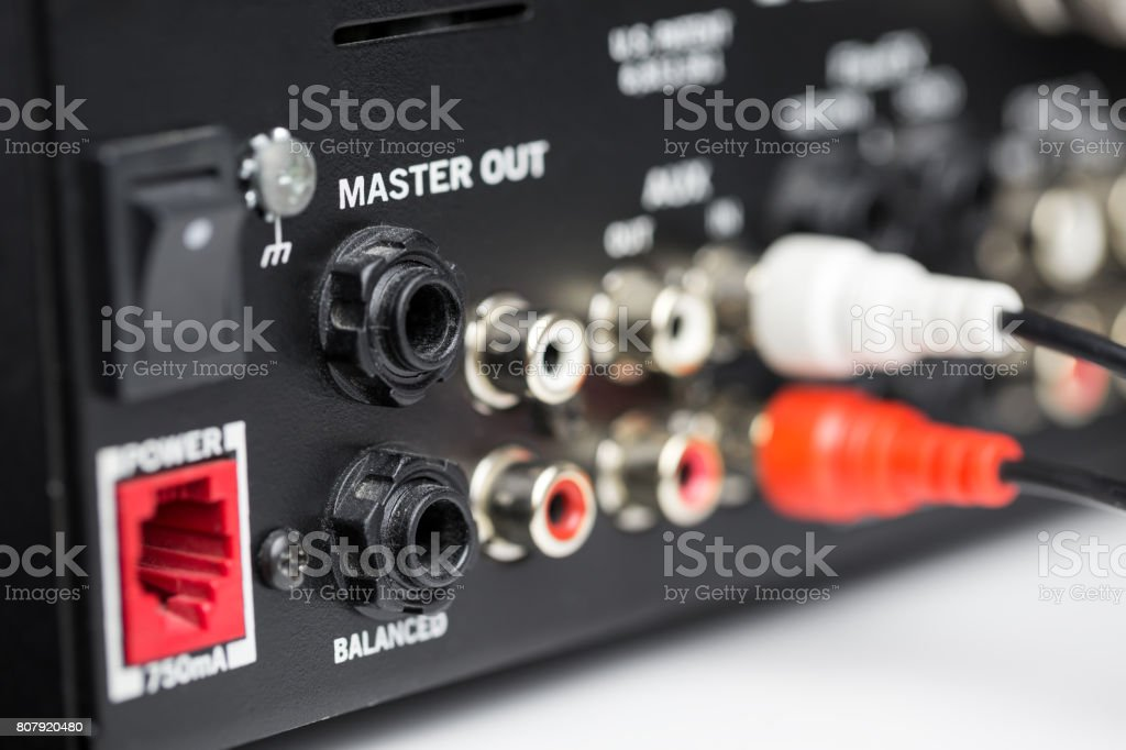 Rca cables on back panel of dj mixer stock photo