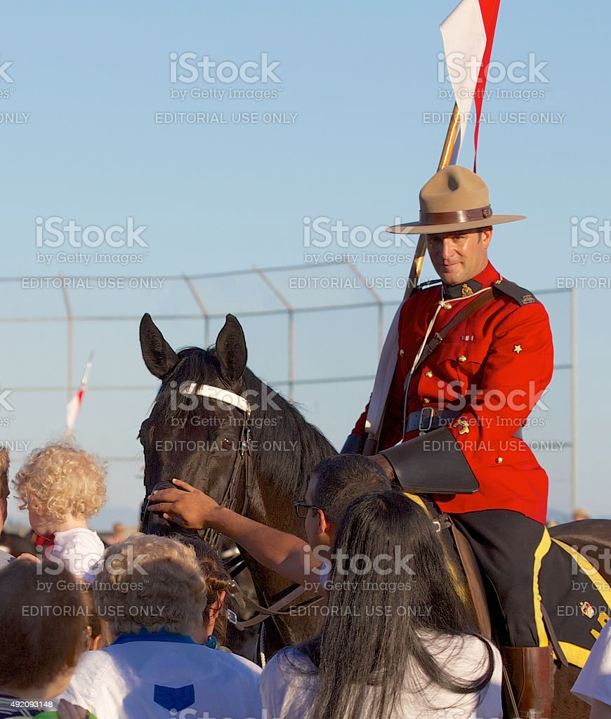 RCMP,Royal Canadian Mounted Police officer greeting fans stock photo