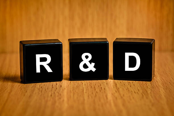 r&d or Research and development text on black block stock photo