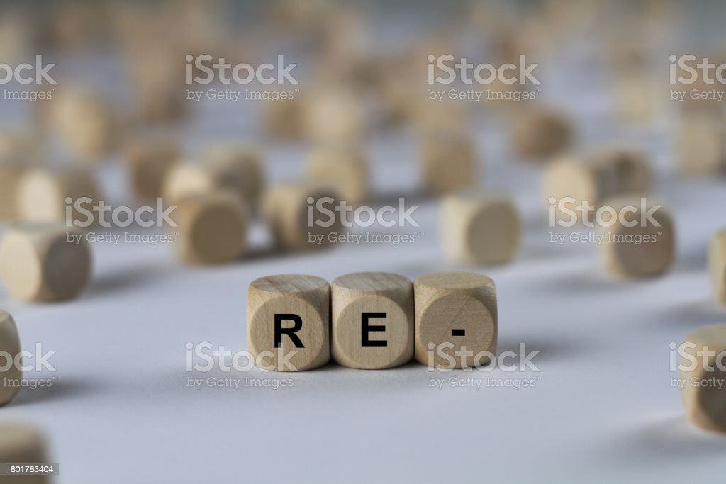 re- - cube with letters, sign with wooden cubes stock photo