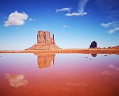 Monument Valley mittens reflected in water