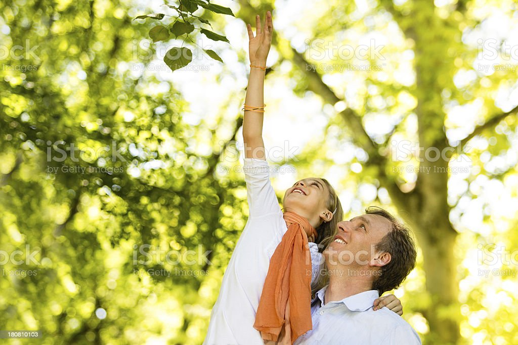 Reaching a tree together royalty-free stock photo