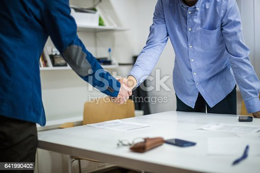 Handshake after signing contract