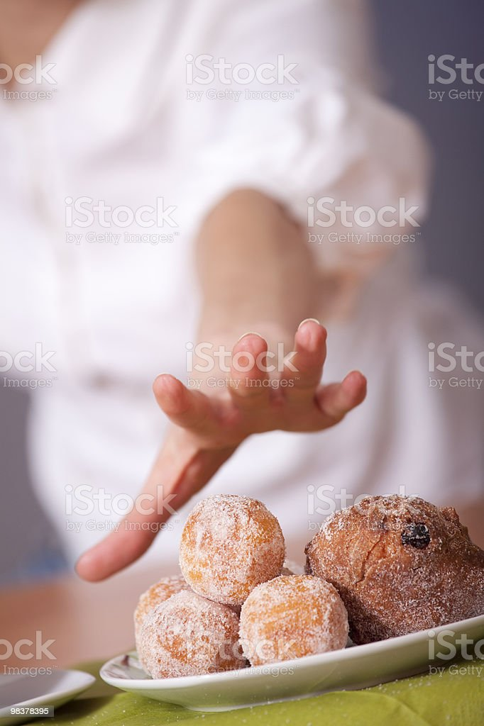 reaching for cakes royalty-free stock photo