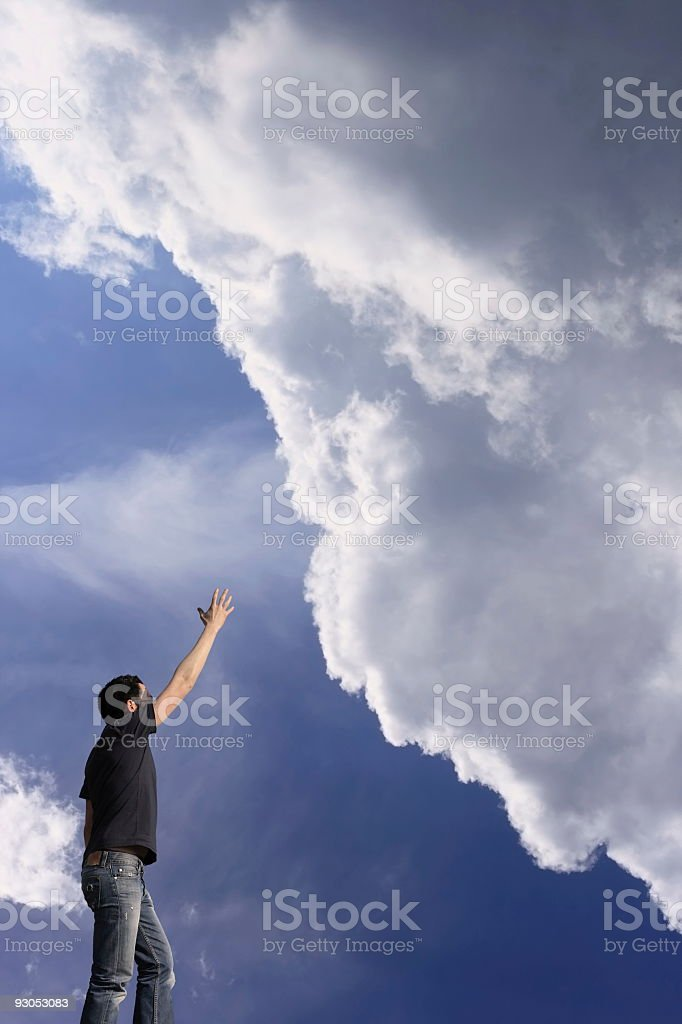 Reaching for clouds royalty-free stock photo