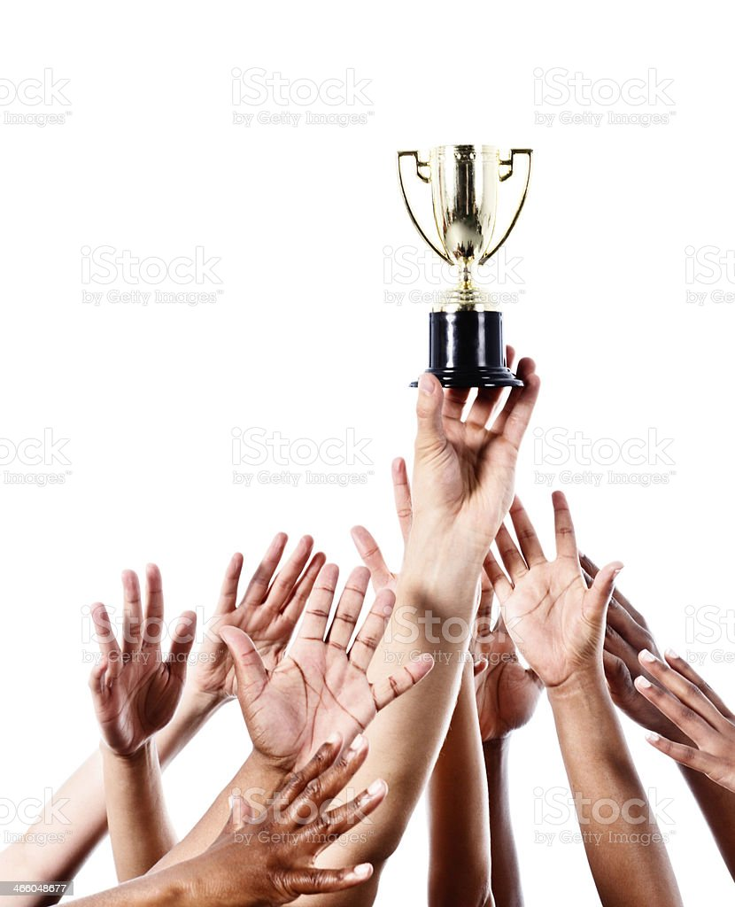 Reaching for glory: many hands pursue silver trophy stock photo