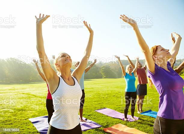Reaching For Good Health Yoga Stock Photo - Download Image Now