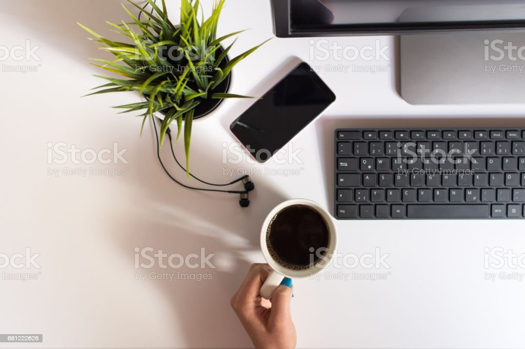 Reaching for her coffee royalty-free stock photo