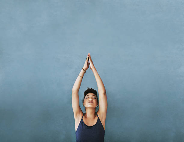 reaching for her fitness goals - yoga stock photos and pictures