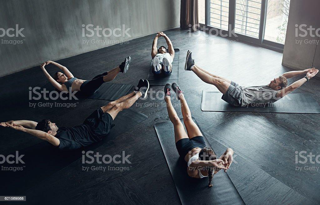 Reaching for our fitness goals photo libre de droits