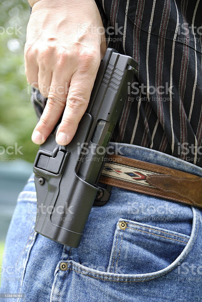 Reaching for the gun royalty-free stock photo