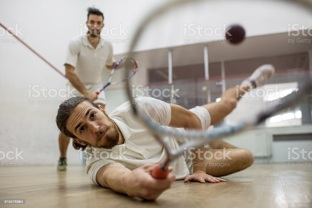Reaching for the squash ball! stock photo