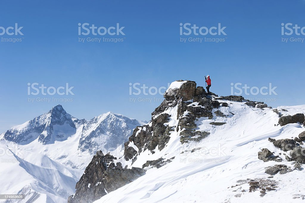 Reaching mountain peek stock photo