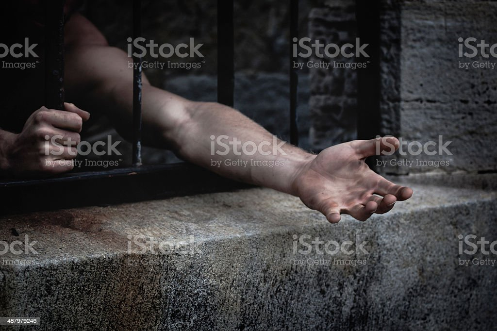 Reaching out from prison stock photo
