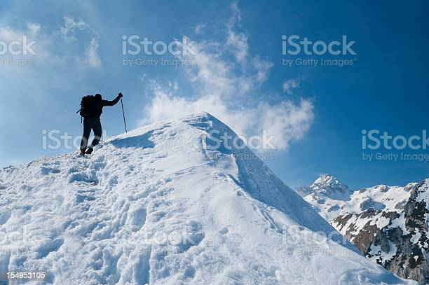 Photo of Reaching the mountain peak in winter