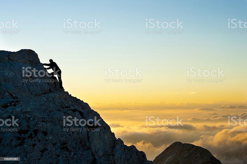 Reaching the mountain peak royalty-free stock photo
