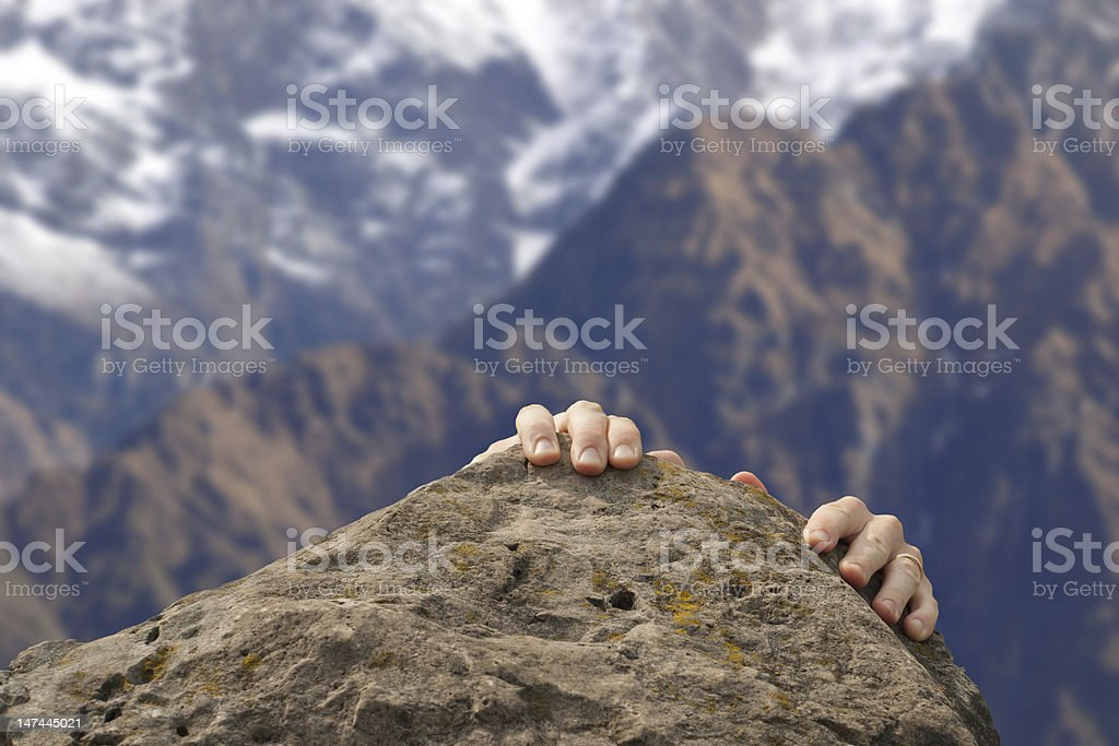 Reaching the peak stock photo
