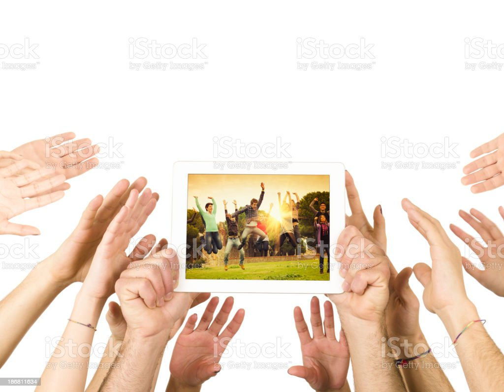 Reaching the technology and digital tablet royalty-free stock photo