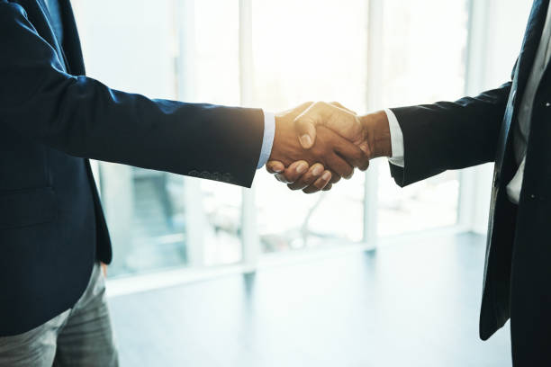 Reaching their business goals together stock photo